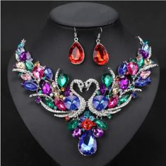 Elegant and cheap jewelry set of earrings and necklace for women. This jewellery set comes in 10 colors like red, blue, green, purple crystals and more. Cheap Jewelry, Jewelry Sets, Dragon Ear Cuffs, Black Leather Bracelet, Horse Jewelry, Crystal Necklace, Crystal Jewelry, Bridal Jewelry, Earring Set