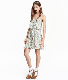 Check this out! Short dress in woven viscose fabric with adjustable shoulder straps, wide ruffle at top, and elasticized seam at waist. Gently flared skirt. - Visit hm.com to see more.
