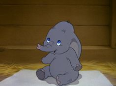 Just looking at this adorable picture makes my eyes well up with happy tears! I <3 Dumbo!