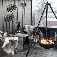 Cabin Style Winter Terrace With Wicker Chairs And A Wooden Table