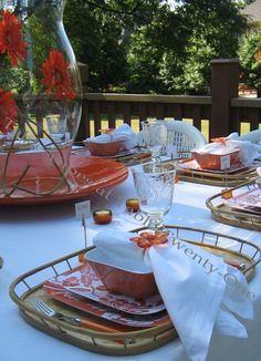 orange summer. love the bamboo trays. Dishes are melamine and glasses are plastic