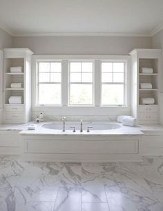 bathroom ideas and designs #KBHomes Not sure of the tiles or the wall colour, but I love the bath and how it's positioned between the cupboards and in front of those windows.