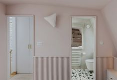 The pale pink – a Little Greene paint shade called China Clay Mid – colours almost everything in the loft, with only a few exceptions.