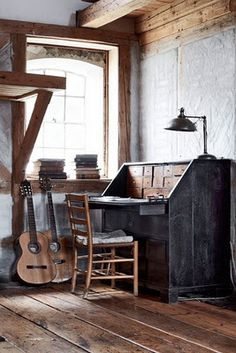 wooden beams, great desk, guitars, windows....inspiration space!