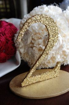 Wedding Table Numbers - Wedding Decorations.. get wood letters and decorate with glitter and glue!