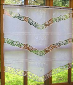 with a little ingenuity, any piece of vintage linen can be turned into a curtain or blind