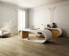 ultra modern and futuristic designed desk but in a traditional setting where crown molding and fine wall detail blend so well with it.
