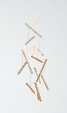 JIN KURAMOTO STUDIO Stick mobile Wooden mobile has expression of an image of floating wood sticks against the force of gravity. When it's cased, sticks are arranged like a puzzle. Feng Shui, Hanging Mobile, Mobile Art, Wood Sticks, Wood Architecture, Kids Decor, Home Decor, Tree Designs, Mobile Design