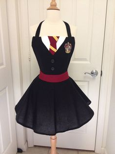 This is an adult size Harry Potter costume apron. Its made of cotton. The skirt is a wrap style that provides full coverage in back yet is adjustable to fit many sizes. Designed to overlap in back with ties that go through buttonholes on the waist belt then tie snugly in back. A perfect way to adjust for many sizes. Skirt length in 14 inches from waist. Waist is approximately 45 with two ties that are each 30. Add a black sweater to complete the look. Great for hosting your favorite party or…