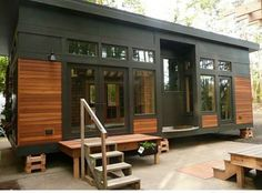 Love the color of the wood of this tiny house exterior. Love the pattern of this tiny house exterior too! Would like in this black or forest green or a dark Navy! Modern Tiny House, Tiny House Living, Tiny House Plans, Tiny House On Wheels, Tiny House Design, Modern House Design, Cottage House, Living Room, Small Living