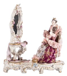 'The toilet', a polychrome decorated figural Saxony porcelain group