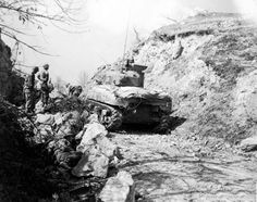 After the 126th Mountain Engineers, 10th Mountain Division cleared a demolition, a tank of the 751st Tank Battalion, who is in support of the 10th Mountain Division, advances on Tole, Italy.
