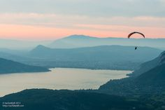 Lake D'Annency, #France. Ethereally lovely for the viewer, slightly terrifying for the parachutist.