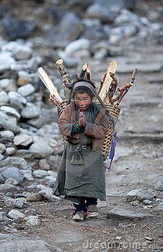Tibetan boy with basket - Gorkha, Nepal ....www.dreamstime.com