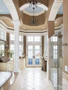 Architectural details provide beauty at every level in this dramatic master bathroom.