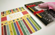 Clever ribbon pencil holder on this altered composition book.