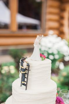 Firefighter wedding cake topper  Photo By Ashley Cook Photography