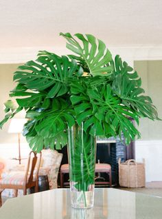 Tropical palm leaf centerpieces: http://www.stylemepretty.com/2016/12/21/family-focused-wedding-day/ Photography: Karen Hill - http://www.karenhill.com/
