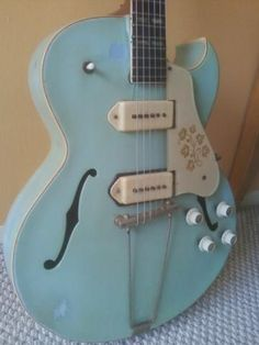 Vintage 1953 Gibson Hollowbody. Blue. Dog ear P-90 pickups in white look great on this.. Look like soap bars? #vintageguitars