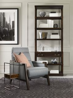 Vanguard Furniture: grey chair with sleek lines & exposed wood features