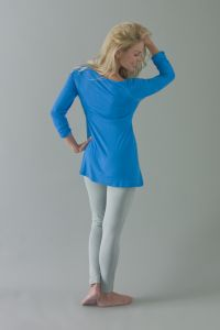 Om Long Sleeve Yoga Top £49.99 The Om yoga top is a long ruched sleeved empire line cut top with a keyhole neck with self fabric ties that do up at the neck, worn untied it gives a whole new dimension to the top. Beneath the keyhole opening on the inner central bust panel lies an integrated discreet pocket which houses the crystals next to the heart chakra. Which come with each top and lie at the heart of Crystal Cups concept.