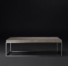 RH Modern's Nicholas Oak Rectangular Coffee Table:Inspired by 1960s French design, our table by Anthony Cox combines the warm texture of wood with a minimalist sculptural form. Its solid oak top rests on a seamless metal frame in an artful pairing of contrasts.