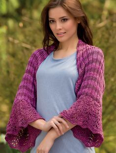 This shrug is not only beautiful, but it's also handy. It slips over one's arms without falling off or needing a shawl pin. It will cover light clothing without the bulk of a sweater. And the lace will brighten anyone's day!