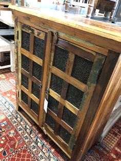 This cabinet is so unique!  It has reclaimed printing blocks built into the door.  There are 16 of them on the front and this piece is stunning along with so functional!  Use as a sideboard in any room in your home or work!  Manzel, 96 Foster St., Peabody, MA and www.manzelinc.com #boho #reclaimedfurniture #rustic #oneofakind Rustic Wood Furniture, Online Furniture Stores, Sideboard, Entryway Tables, Printing, Carving, Cabinet, Boho, Unique