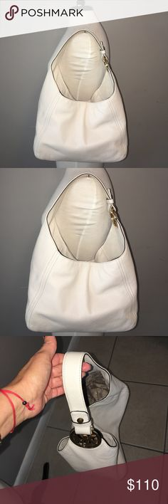 """NWT MICHAEL KORS FULTON SLOUCHY SHOULDER HOBO BAG NWT MICHAEL KORS FULTON LG SLOUCHY SHOULDER HOBO BAG, code AP-1606, genuine off white pebbled leather, gold hardware, Beige MK Monogram inside.  11"""" X 13"""" X 6"""" Great condition, no tears, no flaws, New with price tag $328. Please read the description well, So I do not have to get any returns.  -No holds.  -No trades. -Firm Price, No more discounts, It is not easy to find good prices for reselling, do not ask for lower prices Please. Click the…"""