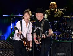INDIO, CA - OCTOBER Musician Neil Young (R) performs with Sir Paul McCartney onstage during Desert Trip at The Empire Polo Club on October 2016 in Indio, California. (Photo by Kevin Mazur/Getty Images for Desert Trip) Desert Trip 2016, Desert Life, Neil Young, Paul Mccartney, Hard Rock, Heavy Metal, Indio California, Southern California, Rock Festivals