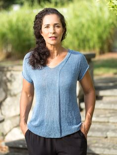 Knit separately in two pieces, this easy knitted tee features a graceful column of stockinette stitch that splits to form the neckline and back neck band.