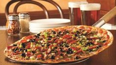 Wisconsin: Special at Zaffiro's Pizza in Milwaukee --- Cheese, sausage, mushrooms and onions (add pepperoni if you're feeling fancy).