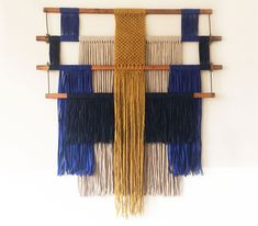 macrame wall hanging made with pieces of an old weaving loom and strips of leftover fabric | ANNIENKE