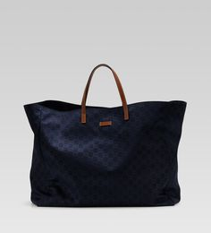 Who doesn't need a navy Gucci beach bag?