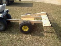 Pinestraw rake in dump position Farm Projects, Backyard Projects, Welding Projects, Outdoor Projects, Lawn Equipment, Garden Equipment, Garden Tractor Attachments, Atv Attachments, Homemade Tractor
