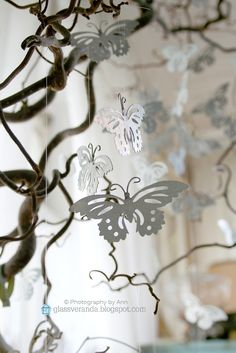 A Corkskrew Hazel in our living room is decorated with flat metal butterflies, - they are in constant movement and an interesting feature in the room. At Easter I use to hang a collection of small colorful eggs here, at Christmas tiny transparent glas angels and reindeers ;)) Styling and photography by Ann, Glassveranda. (glassveranda.blogspot.com)