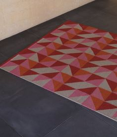 Triangle rug from the designer collection, Armadillo & Co.  Available in a range of colours from a select range of retailers.  Fair trade.  100% New Zealand wool.