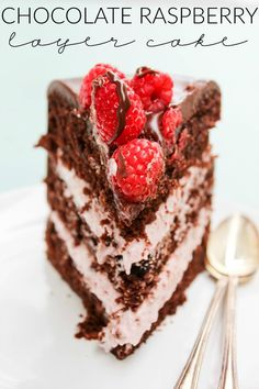 A beautiful and decadent layer cake filled with raspberry cream and topped with ganache & fresh raspberries!!