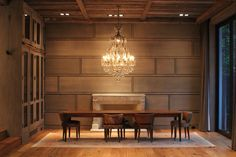 Ideas for paneling dining room contemporary with long wood table vaulted ceilings wood paneling