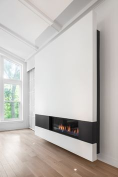 Modern Living Spaces // Design Detail – A Modern Minimalist Fireplace Surround by Thellend Fortin Architects Home Fireplace, Modern Fireplace, Fireplace Surrounds, Fireplace Design, Mounted Fireplace, Gas Fireplaces, Fireplace Ideas, Fireplace Mantels, Minimalist Fireplace