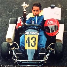 From boy... Hamilton won his first trophy aged eight (above), progressed at school and became a champion at GP2 (below)