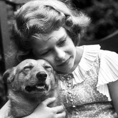Queen Elizabeth and her first Corgie given to her by her father. 1933