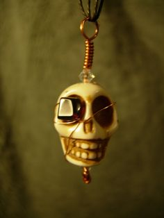 Pirate Skull Necklace with Garnet Eye Patch by TheTeacupandStarCo, $20.00