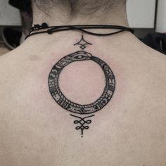 ouroboros tattoo by Ben Lopez @benlopezart
