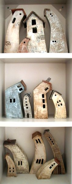 I know these cute bendy buildings are clay but the idea could work for driftwood sculptures.... must try it! More