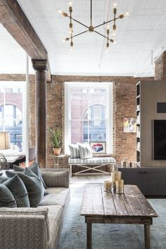 #ad Absolutely love the exposed brick in this comfy living space. Get more design inspiration from #TheDesignNetwork - click through for more! @thedesignnet