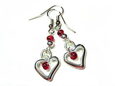 Sweet heart earring. Red glass bead inside silver heart with red and clear accents $10