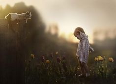"""Russian photographer Elena Shumilova's shots of her two sons, Yaroslav and Vanya, interacting with animals on their farm evoke a fairytale world where little boys become King of the Beasts. She describes how she prefers to use natural light, which she feels gives """"emotional depth to the image,"""" adding that she takes an intuitive approach to her work. """"I get inspired mainly by desire to express something I feel, though I usually cannot tell exactly what it is."""""""