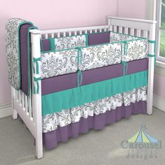 Crib bedding in Solid Emerald Turquoise, Gray Traditions Damask, Solid Aubergine Purple. Created using the Nursery Designer® by Carousel Designs where you mix and match from hundreds of fabrics to create your own unique baby bedding. #carouseldesigns