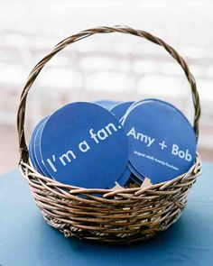 "Worried that the weather might get too hot, the couple decided that fans were a must. They used FanPrinter to create fans with their names and ""I'm a fan"" written on them. ""I love a good pun,"" Amy says. ""It was a total breeze to work with them!"""